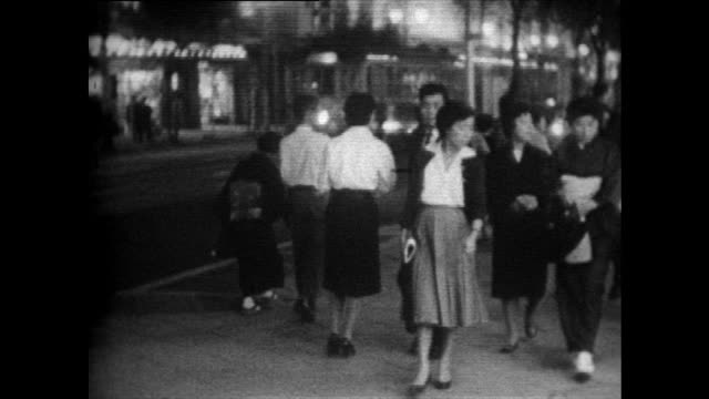 busy pavement full of people walking in tokyo; 1958 - 1958 stock videos & royalty-free footage