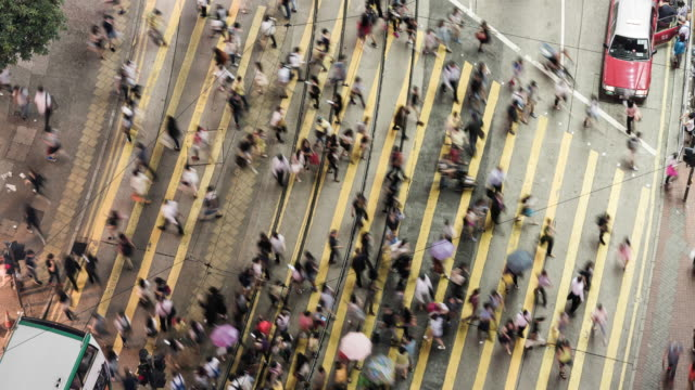busy pedestrian crossing, hong kong island