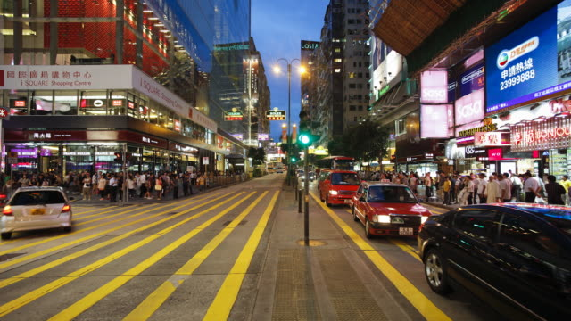 Busy Pedestrian crossing on Nathan Road, Kowloon, Hong Kong, China, Time-lapse