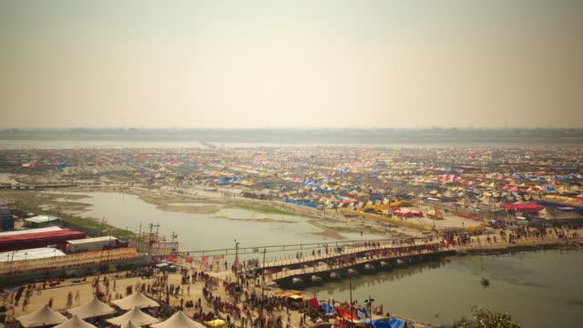 busy pilgrim activity over temporary bridge, kumbh mela festival - pilgrim stock videos & royalty-free footage