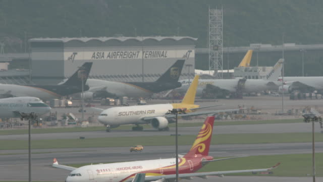 busy planes at airport - hong kong international airport stock videos & royalty-free footage