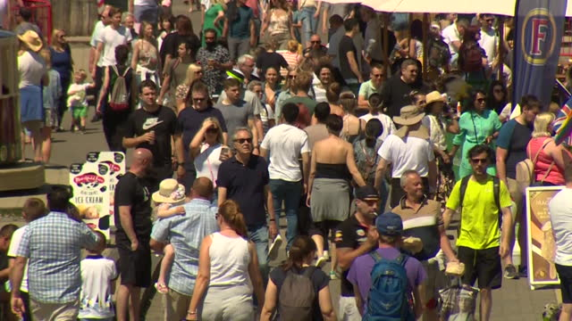 busy promenade at brighton beach on a very sunny bank holiday monday, as lockdown eases during coronavirus pandemic - sunny stock videos & royalty-free footage