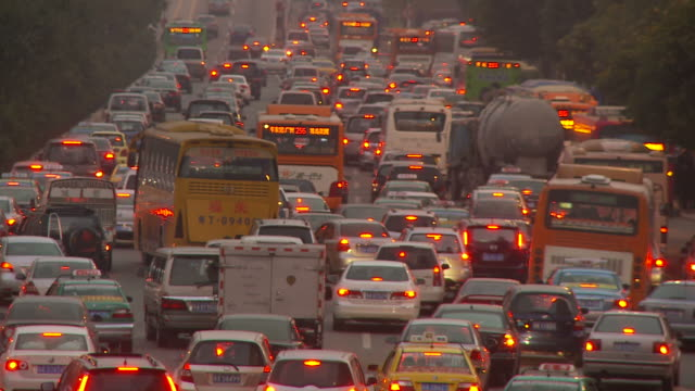 busy rush hour traffic in guangzhou china - 2010 stock-videos und b-roll-filmmaterial