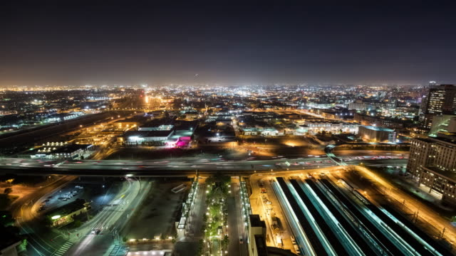 A Busy Scene of Cars, Trains, Buses and Helicopters Above Downtown Los Angeles at Night