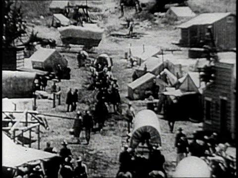 reenactment busy scene on settlement street / united states - 探検家点の映像素材/bロール