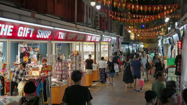 singapore - november 7, 2018: busy shopping street in chinatown at night time - pedestrian stock videos & royalty-free footage