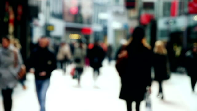 stockvideo's en b-roll-footage met busy shopping street in slow motion - walking