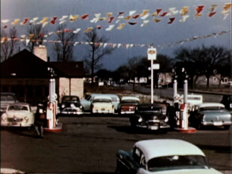 / xws busy sinclair gas station on a corner / ms sinclair gas pumps with glass globes / ws service station pan right across pump islands / xws pan... - gas station attendant stock videos and b-roll footage