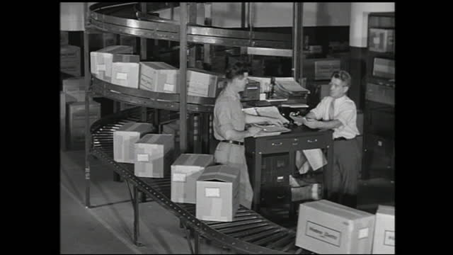 busy stockyard full of workers loading and unloading; man with clipboard writing standing on spool of cable; man loading large spools of cable; two... - 1940 1949 stock videos & royalty-free footage