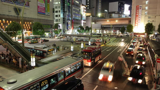 T/L WS HA Busy street and bus station at night / Tokyo, Japan