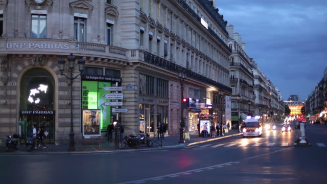 ws busy street at dusk / paris, france - ambulance stock videos & royalty-free footage