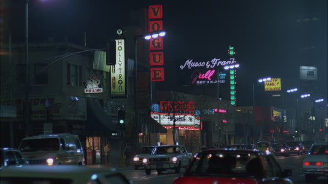 ms busy street at night / hollywood, california, united states - 1987 stock-videos und b-roll-filmmaterial
