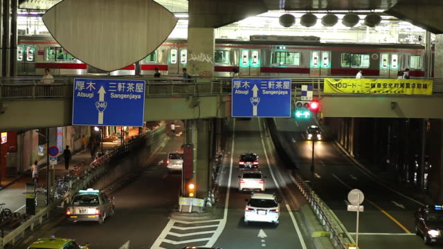 ws busy street at night / tokyo, japan - elevated train stock videos and b-roll footage
