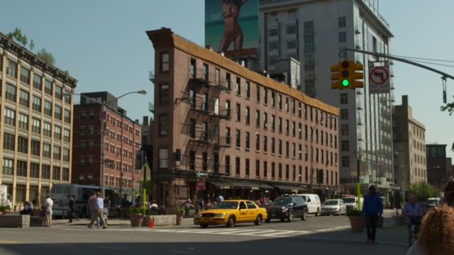 a busy street corner in the meatpacking district on the corner of 9th avenue and 14th street. - apple store stock videos & royalty-free footage