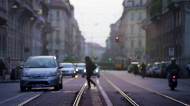 busy street, evening hours - railway track点の映像素材/bロール
