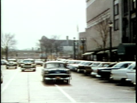 1963 MONTAGE WS PAN DISSOLVE POV Busy street from moving car / Chicago, United States / AUDIO