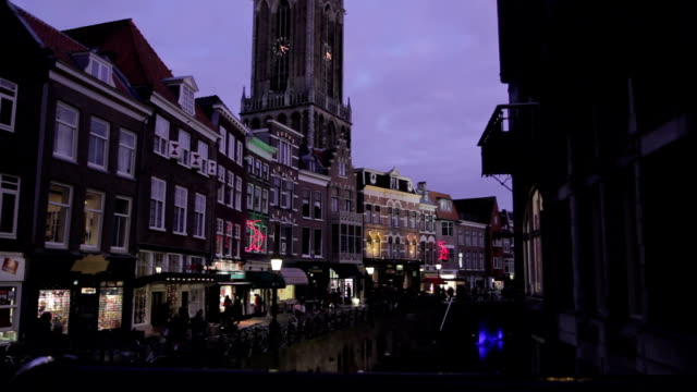busy street in europe at dusk - utrecht stock videos & royalty-free footage