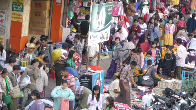 m/s busy street in front of shopping mall in mandalay, myanmar - mandalay stock videos and b-roll footage