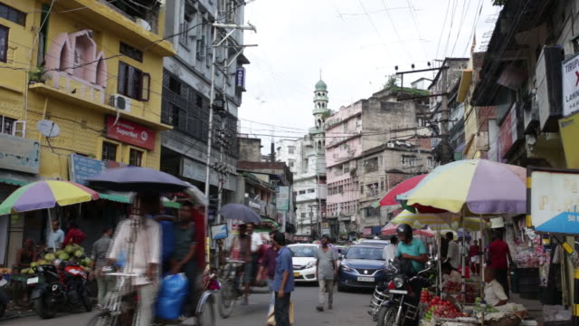 busy street in guwahati assam india on saturday august 31 2019 a sense of betrayal and anger is growing in muslim communities which are most affected... - risciò video stock e b–roll