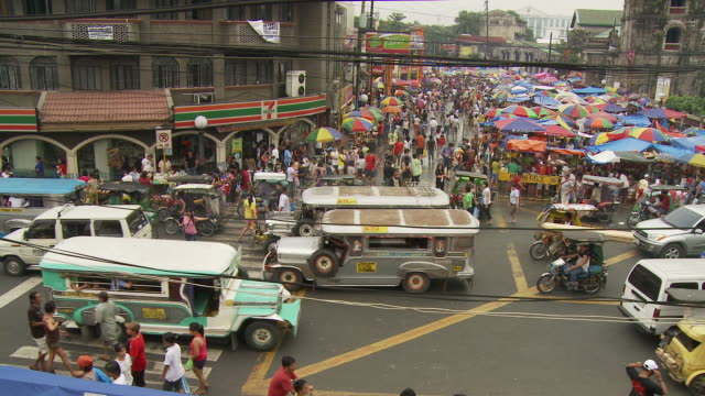 busy street in manila philippines - filippine video stock e b–roll