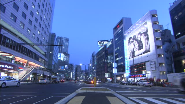 busy street in tokyo at dusk - western script stock videos & royalty-free footage