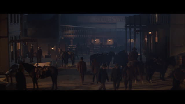 ms reenactment busy street in western town at night - wild west stock videos & royalty-free footage