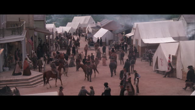 ms reenactment busy street in western town - wild west stock videos & royalty-free footage
