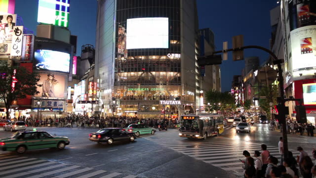 ws busy street intersection at night / tokyo, japan - bus billboard stock videos & royalty-free footage