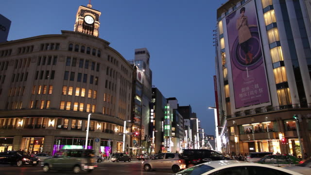 ws busy street intersection at night / tokyo, japan - ginza stock videos & royalty-free footage