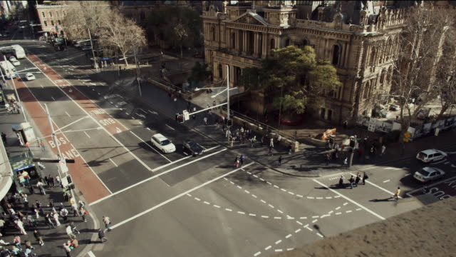 t/l ws ha busy street intersection at sydney town hall / sydney, new south wales, australia - urban road stock videos & royalty-free footage