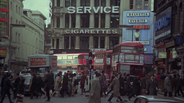 1966 ws busy street / london, united kingdom - 1966 stock-videos und b-roll-filmmaterial