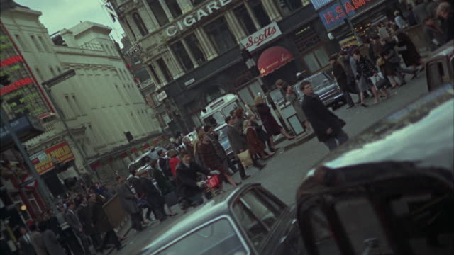 1966 ws canted busy street / london, united kingdom - 1966 stock videos & royalty-free footage