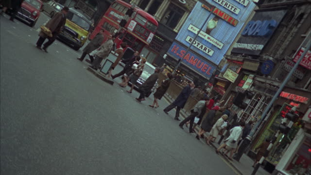 1966 ws canted busy street / london, united kingdom - 1966 stock videos and b-roll footage