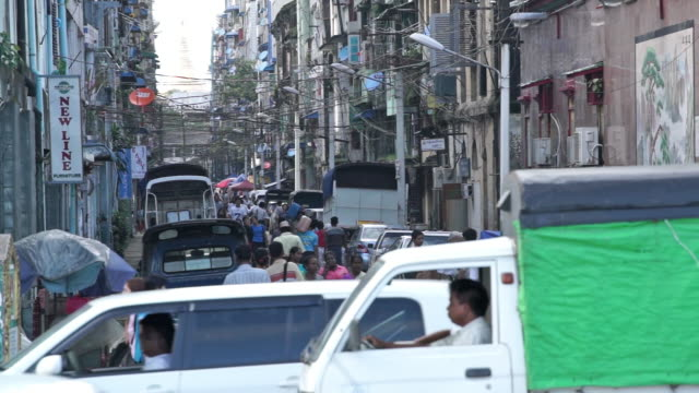 a busy street looking towards the shwedagon pagoda in yangon, myanmar - 2013 stock videos and b-roll footage
