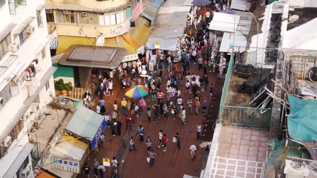 busy street market in sham shui po, hong kong. wide shot, day - spoonfilm stock-videos und b-roll-filmmaterial