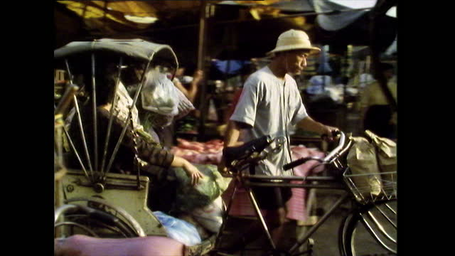 busy street market with people and pedicabs; chiang mai, 1989 - thailand stock videos & royalty-free footage
