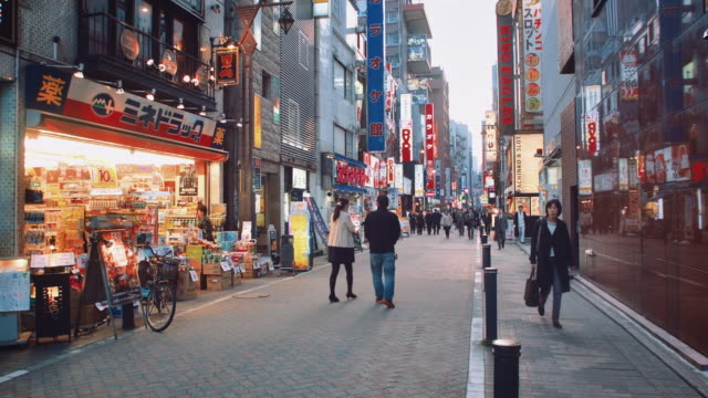 WS, Busy street of Shinbashi district, salarymen walking by