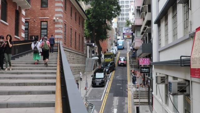 busy street on hong kong island, china - hong kong island stock videos & royalty-free footage