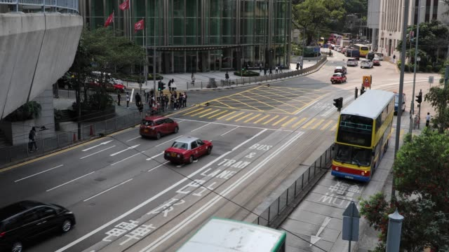 busy street on hong kong island, china - hong kong stock videos & royalty-free footage