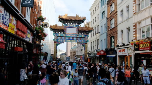 a busy street scene in chinatown, london - chinatown stock videos & royalty-free footage