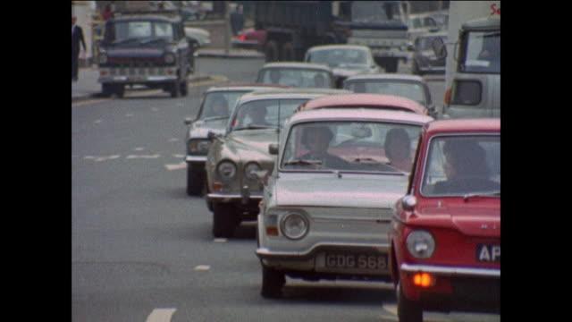 busy street traffic, cars - 1971 stock-videos und b-roll-filmmaterial