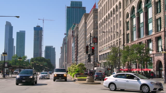 busy street traffic in city / chicago, usa - traffic light stock videos & royalty-free footage
