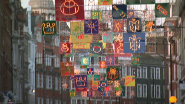 ms tu td busy street with christmas decorations hanging above / london, united kingdom - christmas decoration stock videos & royalty-free footage