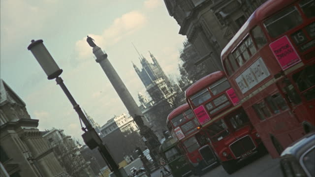 1966 ws zi canted busy street with duke of york statue and victoria tower in background / london, united kingdom - 1966 stock videos and b-roll footage