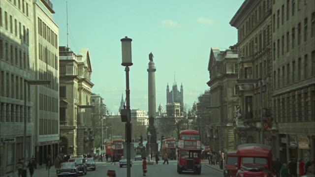 1966 ws zi busy street with duke of york statue and victoria tower in background / london, united kingdom - 1966 stock videos and b-roll footage