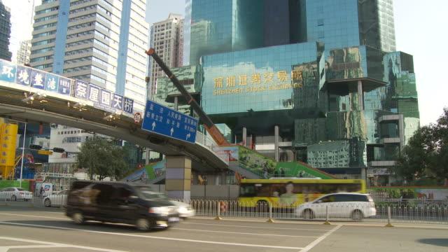 Busy street with Shenzhen Stock Exchange building in Shenzhen China