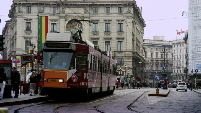 Busy street with tram.