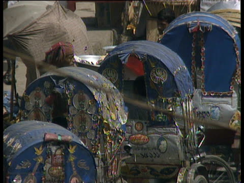 busy streets crowded with a mass of colourful decorated rickshaws bangladesh - bangladesh stock videos & royalty-free footage