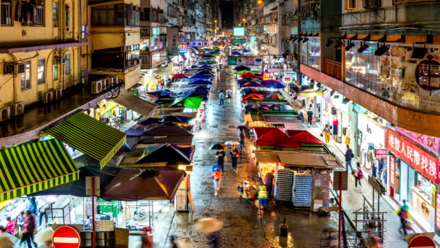 busy streets in mongkok, kowloon, hong kong - prosperity stock videos & royalty-free footage