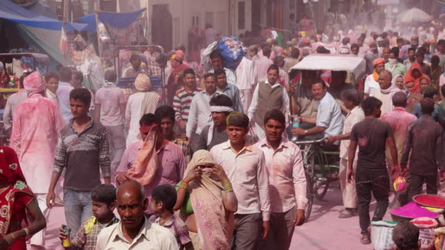 busy streets of barsana village during holi festival - arid stock videos & royalty-free footage